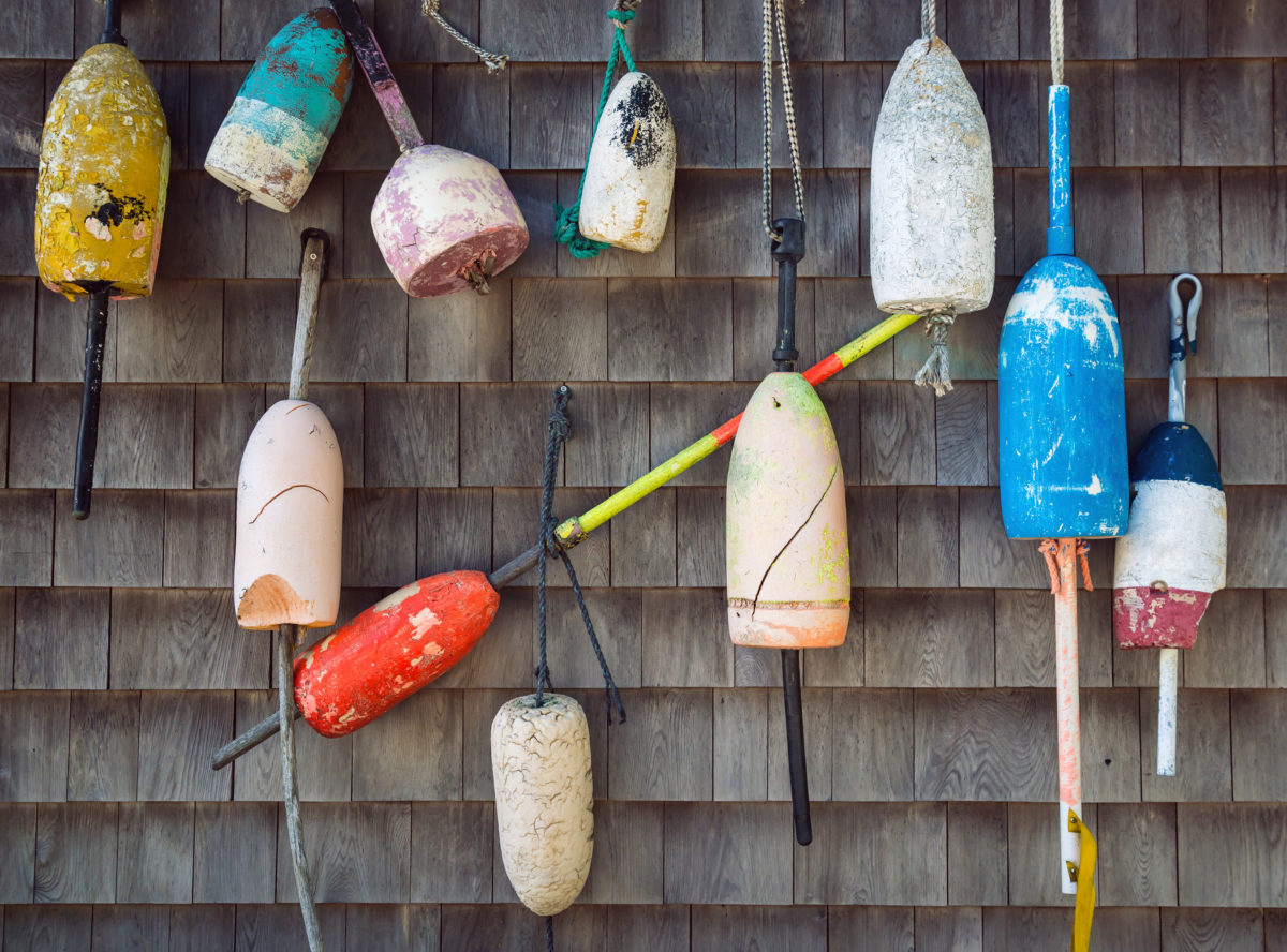 Old lobster buoys hanging on the wall
